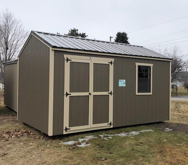 Ranch, Brown Metal Roof, One Window, Double Doors.