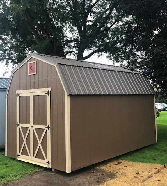 brown with tan trim, brown metal roof, 5' double doors, sky light, ramp